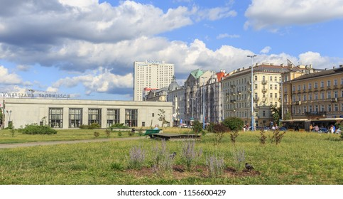WARSAW, POLAND. AUGUST 2018: A view of tenements at Aleje Jerozolimskie Avenue and building of  Warszawa Srodmiescie Railway Station in very center of Warsaw. Railway tracks run in tunnel