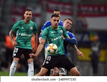 Warsaw, Poland, August 22, 2019: UEFA Europa League qualification round Legia Warszawa - Glasgow Rangers FC: Sandro Kulenovic (Legia Warszawa) Steven Davis (Rangers FC) in action