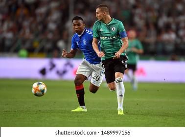 Warsaw, Poland, August 22, 2019: UEFA Europa League qualification round Legia Warszawa - Glasgow Rangers FC: Alfredo Morelos (Rangers FC) Artur Jedrzejczyk (Legia Warszawa) in action