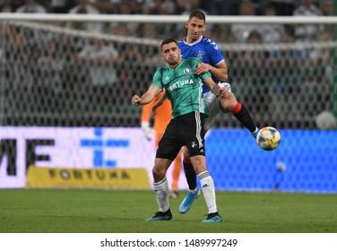 Warsaw, Poland, August 22, 2019: UEFA Europa League qualification round Legia Warszawa - Glasgow Rangers FC: Sandro Kulenovic (Legia Warszawa) Nikola Katic (Rangers FC) in action