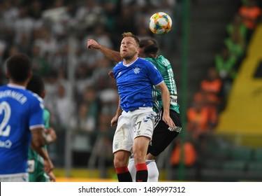 Warsaw, Poland, August 22, 2019: UEFA Europa League qualification round Legia Warszawa - Glasgow Rangers FC: Scott Arfield (Rangers FC) headers the ball