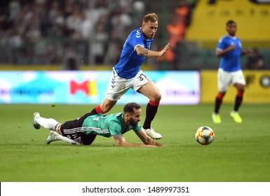 Warsaw, Poland, August 22, 2019: UEFA Europa League qualification round Legia Warszawa - Glasgow Rangers FC: Luis Rocha (Legia Warszawa) Scott Arfield (Rangers FC) in action