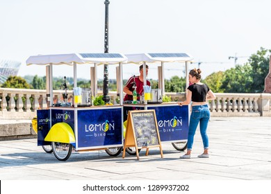 Warsaw, Poland - August 23, 2018: Old town street in capital city during sunny summer day on Castle Square and people buying from lemon stand