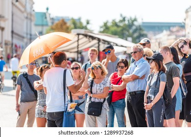 Warsaw, Poland - August 23, 2018: Famous old town historic Castle Square in capital city during sunny summer day crowd of people free tour guide