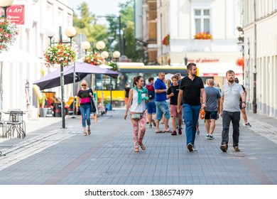 Warsaw, Poland - August 23, 2018: Old town cobblestone street people tourists walking on summer day cobbled road