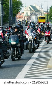 WARSAW, POLAND - AUGUST 23: Motorcyclists on 14th Motorcycle Katyn Rally on August 23, 2014 in Warsaw, Poland. The aim of the rally is to pay tribute to 22000 Polish officers killed in 1940 by Soviets
