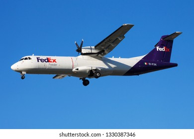 WARSAW / POLAND - AUGUST 27, 2013: FedEx Feeder ATR-72 EI-FXK cargo plane landing at Warsaw Chopin Airport