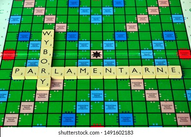 Warsaw, Poland - August 29 2019: PARLIAMENTARY (polish: parlamentarne) and ELECTIONS (polish: wybory) words made from Scrabble game tiles. Scrabble letters on the game board.
