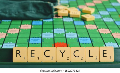 Warsaw, Poland - August 31 2019: RECYCLE word made from Scrabble game tiles. Scrabble letters spelling the message. Scrabble tiles on the stand. Selective focus shot. Ecology theme