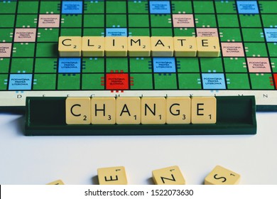 Warsaw, Poland - August 31 2019: CLIMATE, CHANGE word made from Scrabble game tiles. Scrabble letters spelling the message. Scrabble tiles on the stand. Ecology theme