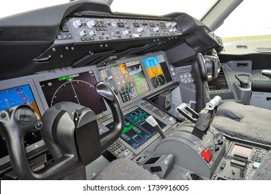 WARSAW, POLAND - AUGUST 4, 2013: View of the cockpit of a Boeing 787 Dreamliner aircraft.