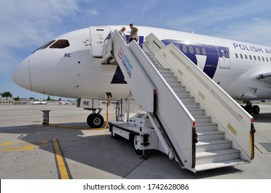 WARSAW, POLAND - AUGUST 4, 2013: Crew prepare the aircraft Boeing 787 Dreamliner of the LOT Polish Airlines for departure at Chopin Airport.