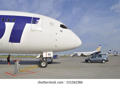 WARSAW, POLAND - AUGUST 4: Passenger under the fuselage Boeing 787 Dreamliner while preparing the aircraft LOT Polish Airlines for departure at Chopin Airport on August 4, 2013 in Warsaw, Poland.