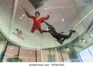 WARSAW, POLAND, AUGUST 5, 2017: Young men enjoying flying in an aerodynamic tunnel.