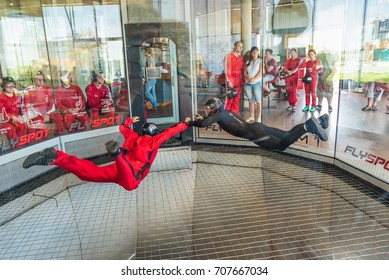 WARSAW, POLAND, AUGUST 5, 2017: Young man flying in an aerodynamic tunnel with instructor. Poland.