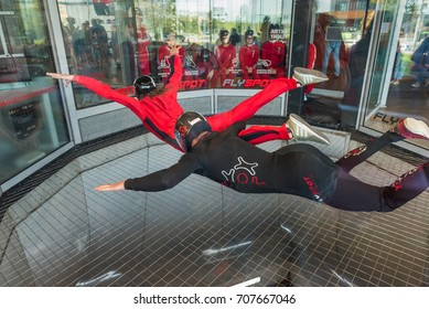 WARSAW, POLAND, AUGUST 5, 2017: Young men flying in an aerodynamic tunnel with trainer. Poland.