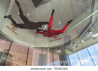 WARSAW, POLAND, AUGUST 5, 2017: Young man flying in an aerodynamic tunnel with trainer. Poland.