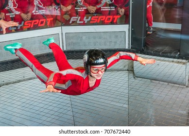 WARSAW, POLAND, AUGUST 5, 2017: Young woman flying in an aerodynamic tunnel.