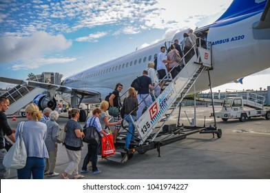 Warsaw, Poland - August 8, 2011: Passengers get on board of B737-800 Boeing plane of Enter Air charter airline at Chopin Airport in Warsaw