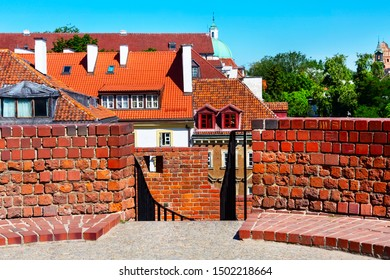 Warsaw, Poland Barbican or Barbakan medieval outpost with the defense walls in historic old town quarter and houses view