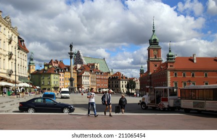 WARSAW, POLAND, CIRCA 2013 - TOurists go via the central old town square circa 2013 in Warsaw, Poland