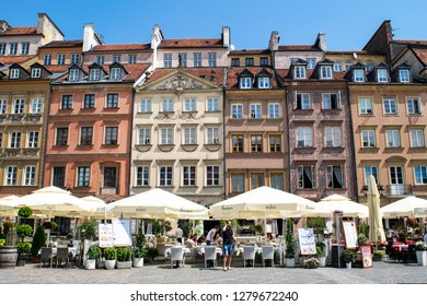 WARSAW, POLAND - CIRCA MAY 2018: Unidentified people walk through Old Town Market Place