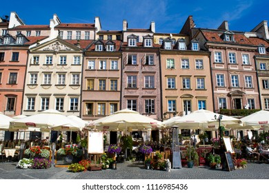 WARSAW, POLAND - CIRCA SEPTEMBER 2016: Unidentified people walk through past restored buildings in the Old Town