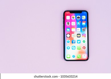 WARSAW, POLAND - DECEMBER 02, 2017: New Iphone X mobile phone on pink background with copy space