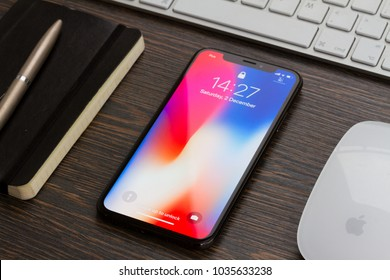 WARSAW, POLAND - DECEMBER 02, 2017: New Iphone X mobile phone with notebook and keyboard