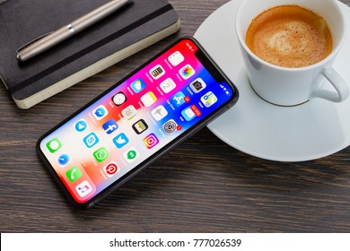 WARSAW, POLAND - DECEMBER 02, 2017: New Iphone X mobile phone with cup of coffee