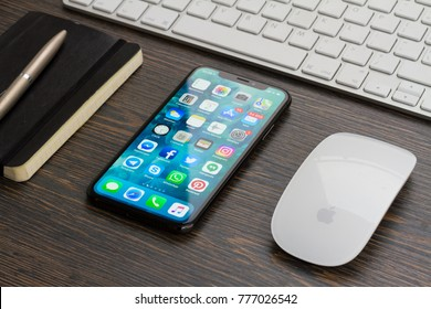 WARSAW, POLAND - DECEMBER 02, 2017: New Iphone X mobile phone with cup of colorful apps icons