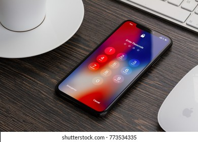 WARSAW, POLAND - DECEMBER 02: New Iphone X mobile phone with password page on working desk