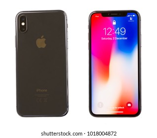 WARSAW, POLAND - DECEMBER 02: View of new Iphone X mobile phone back and face with apps over white background