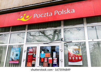 Warsaw, Poland - December 25, 2019: Entrance door with facade to Poczta Polska or Polish Post Office branch in Warszawa with nobody