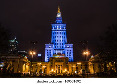WARSAW, POLAND - DECEMBER 29: Palace of Culture and Science built in socialism realism style as a gift for Poland from USSR in 1955 surrounded by modern skyscrapers on December 29, 2013.