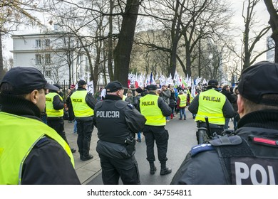 WARSAW, POLAND - DECEMBER 3, 2015: Polish democracy activists of 'Committee for the protection of democracy' (KOD) demonstrate at the front of the Constitutional Court  in Warsaw, Poland