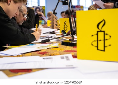 """Warsaw / Poland - December 9, 2018: """"Write for Rights"""" is human rights event organized by Amnesty International. Activists write letters to those, whose human rights are being attacked"""
