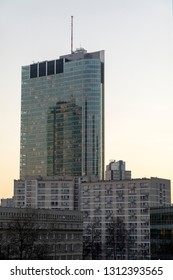 Warsaw, Poland, February 2019: Modern skyscrapers in the downtown district of Warsaw, Poland. A view from street level during the sunset.