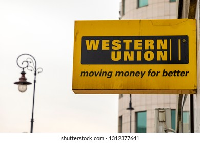 Warsaw, Poland, February 2019: A Western Union money transfer sign outside a business. Western Union works with local agents to facilitate transferring money internationally.