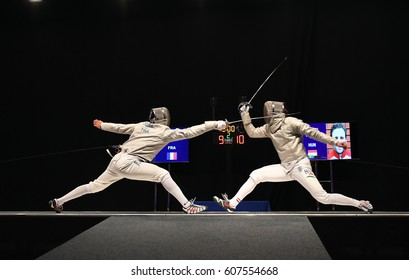 WARSAW, POLAND FEBRUARY 25, 2017: Sabre de Wolodyjowski,  International Fencing Federation Fencing Cup in mens sword FIA in Politechnika Warszawska Hall o/p international fencing duel in men's sword