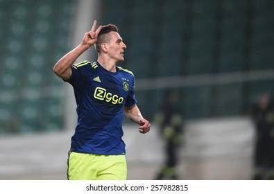 WARSAW, POLAND - FEBRUARY 26, 2015 : UEFA Europa League play off stage Legia Warsaw Ajax Amsterdam Daley Sinkgraven Ivica Vrdoljak