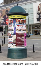 Warsaw, Poland - February 28, 2016: Advertising column placed next to shopping malls. An advertising column presents posters and billboards on it. Advertising pillar is one way of outdoor advertising
