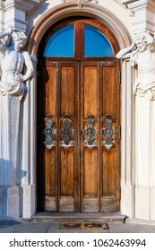 WARSAW, POLAND - JANUARY 13, 2008: Richly ornamented door with atlants at the baroque Wilanow Royal Palace
