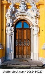 WARSAW, POLAND - JANUARY 13, 2008: Richly ornamented door with cupids and atlants at the baroque Wilanow Royal Palace