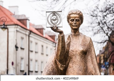 WARSAW, POLAND - JANUARY 2, 2015: Sculpture of Marie Sklodowska-Curie by polish sculptor Bronislaw Krzysztof. The Nobel prize winning scientist is holding a graphic symbol of Polonium in her hand.