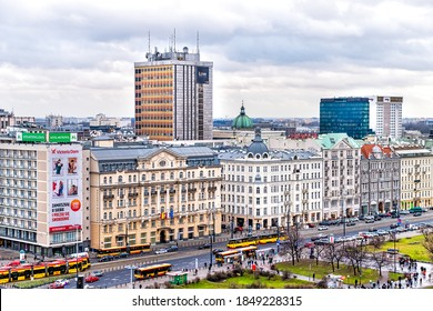 Warsaw, Poland - January 22, 2020: High angle aerial view of Warszawa cityscape skyline near centralna train station and signs on buildings