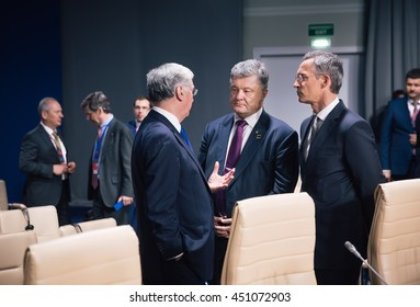 WARSAW, POLAND - Jul 9, 2016: Defense Minister of Great Britain Michael Fallon, NATO Secretary General Jens Stoltenberg and President Ukraine Petro Poroshenko at NATO summit in Poland