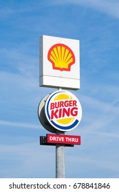 Warsaw, Poland - July 08, 2017: Shell and Burger King pylon on blue sky background near the highway.