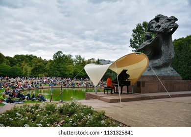 WARSAW, POLAND - JULY 1,2018. People at Chopin Concerts in the Royal Lazienki Park. Julia Kociuban is the first pianist who acting in july 2018.