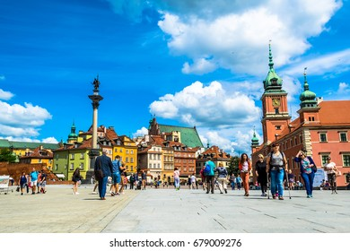 Warsaw, Poland – July 14, 2017: Plac Zamkowy - The castle square in Warsaw is located between the Warsaw royal palace and the Warsaw Old Town. Sunny summer day. Horizontal photo.